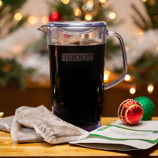 Clear pitcher with cold brew at home with festive lights
