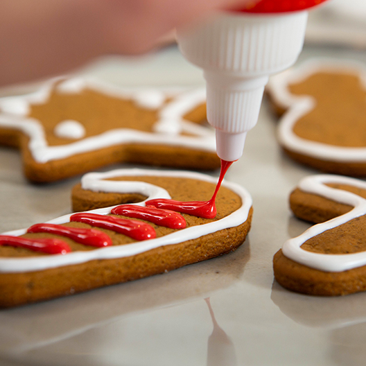 Cold Brew Gingerbread Cookies with white and red frosting