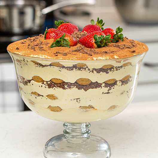 Toddy Tiramisu topped with strawberries in a large serving dish