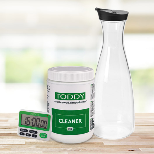 Toddy Timer, Cleaner and Carafe on a counter top