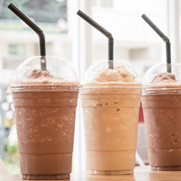 Toddy frappe lineup with chocolate and vanilla frappes in plastic cups with straws